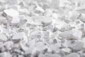 Calcium chloride (CaCl2) flakes. Common applications include brine for refrigeration plants, ice and