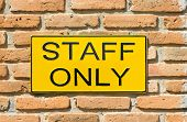 Staff Only Sign On Brick Wall.