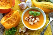 Bowl with pumpkin soup