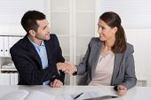 Business talk with shaking hands: counselor and customer or hello to a new colleague.
