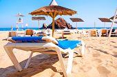 beach lounger with an umbrella on a beach