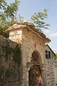 picture of old stone fence  - old stone fence and gate in a small village in Montenegro - JPG