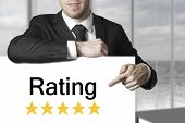 Businessman Pointing On Sign Rating Stars
