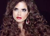 Beauty Fashion Girl. Wavy Long Hair. Brunette Model With Red Lips, Makeup And Curly Hairstyle.