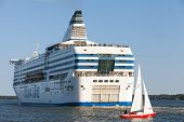Silja Line Ferry And Small Sailboat Sail From Port Of Helsinki