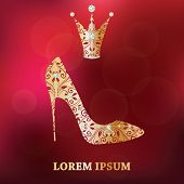Golden shoe with abstract flower decor on blurred background