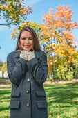 Smiling Pretty Woman Chilling in Gray Coat Looking at Camera. Captured Outdoor. Isolated on Nature V