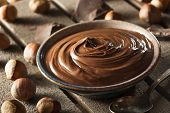 foto of hazelnut  - Homemade Chocolate Hazelnut Spread on a Background - JPG