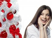 closeup portrait of attractive  caucasian smiling woman brunette isolated on white studio shot lips toothy smile face hair head and shoulders tooth christmas