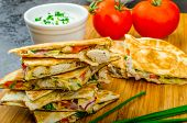 foto of chive  - Chicken quesadilla with tomato red onions parsley and red pepper fresh salad and creame sour - JPG