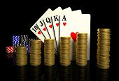 Casino chips,golden coins and cards isolated on black