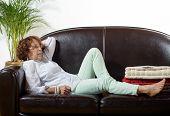 A Woman Lying On A Sofa