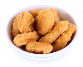 Fried chicken nuggets in bowl isolated on white