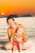 Baby and mother on the tropical beach