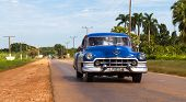 HAVANA,CUBA - June 23, 2014: Blue classic car on the road in the inland