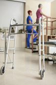 Elderly lady with her physiotherapists in a hospital