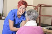 stock photo of physiotherapist  - Elderly lady with her physiotherapists in a hospital - JPG