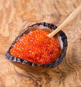Red Caviar In Wooden Bowl On Olive Wood Background