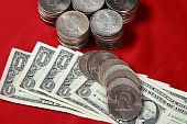 USA dollar bills and silver coins