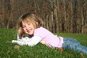 Smiling Girl Lying in Grass