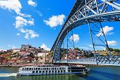 foto of dom  - The Dom Luis I Bridge is a metal arch bridge that spans the Douro River between the cities of Porto and Vila Nova de Gaia Portugal - JPG