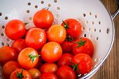 Fresh Organic Ripe Cherry Tomatoes With Drops In White Colander