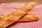 French bread isolated on checkered napkin