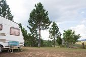 foto of camper  - mobile camper on camping site with nature view