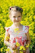 Little Girl In Yellow Rape Field