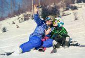 Mother and little son selfie on the ski slope resort