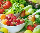 stock photo of fruit bowl  - Fresh organic fruits and vegetables close - JPG