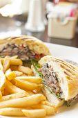 foto of portobello mushroom  - Portobello mushroom sandwich on a toasted ciabatta bun and side of fries - JPG