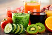foto of fruit-juice  - Glasses of fresh organic vegetable and fruit juices. Detox diet.