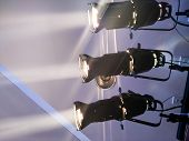 stock photo of  rig  - multiple spotlights on a theatre stage lighting rig