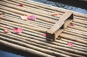 picture of raft  - Bamboo raft with wood seat ready for travel - JPG