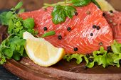 picture of redfish  - Fresh salmon with lemon parsley and pepper close up - JPG