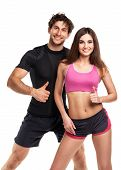 Athletic Man And Woman After Fitness Exercise With A Finger Up On The White