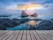 image of shipwreck  - Ancient shipwrecks in the sea with sunset background - JPG