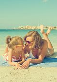 Happy Woman And Little Girl On The Beach.