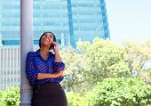Business Woman Laughing On Cell Phone Outside Office Building