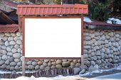 Blank authentic billboard in the street on stone wall background