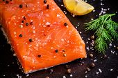 Fresh Salmon Fillet With Dill And Lemon Closeup