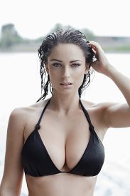 foto of wet  - Sexy woman in bikini with wet hair and big tits at summer - JPG
