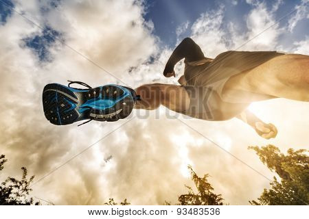 poster of Outdoor cross-country running low angle view under runner concept for exercising, fitness and health