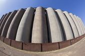 stock photo of silos  - Agriculture Grain silos  structure closeup curved detail abstract - JPG