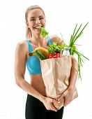 Happy Smiling Youing Woman With Lettuce In Her Mouth And Grocery Bag Full Of Healthy Fruits And Veg poster