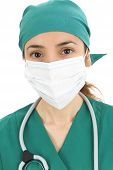 pic of female mask  - Female doctor wearing a surgical mask close up - JPG