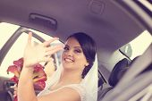 stock photo of calla  - Beautiful bride holding a white and red calla lily - JPG