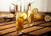 picture of iced-tea  - Long island ice tea coctails on wooden and white background - JPG