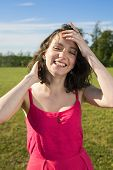 image of flirty  - Young female smiles flirty to a camera - JPG